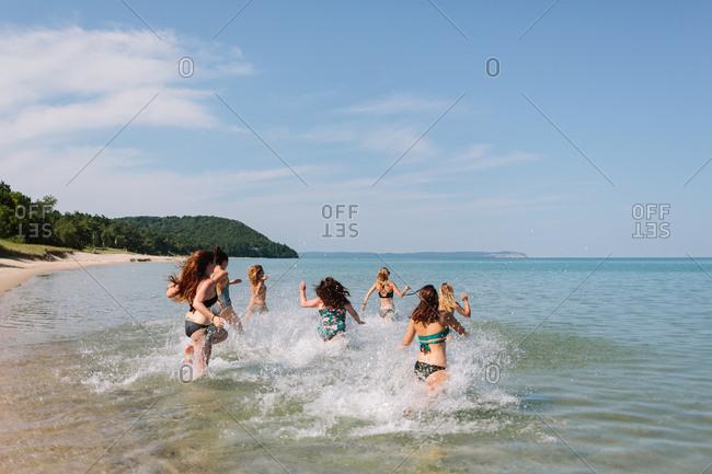 Women splashing into the lake for a swim