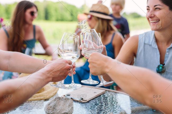 Smiling women enjoying white wine