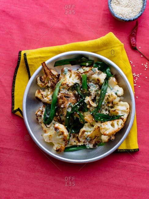 Fried cauliflower with tahini yoghurt sauce and herbs