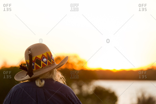 Australian elder staring out into the sunset