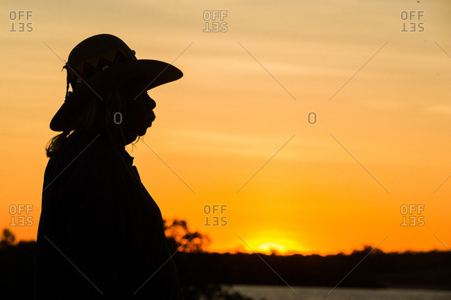 Silhouette of Australian elder at sunset