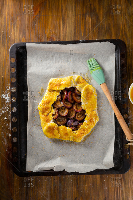 Rustic plum galette on baking tray