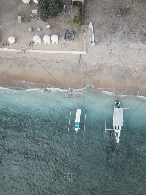 Aerial view of boats moored at shore, Nusa Penida island, Bali, Indonesia