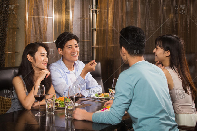 Young people in the restaurant for dinner