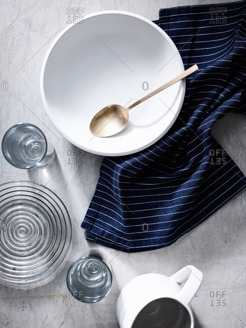 Overhead view of dishes and towel on light background