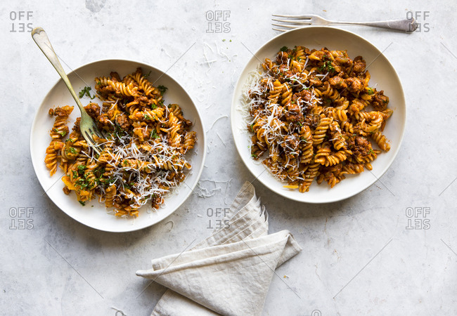 Plates of pasta in meat sauce