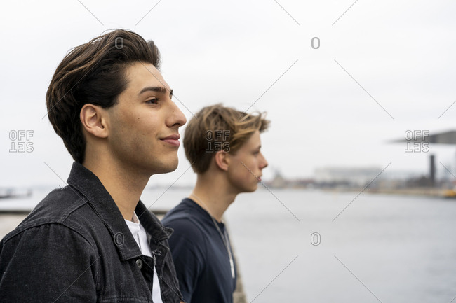 Denmark- Copenhagen- portrait of two young men at the waterfront