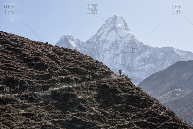 Nepal- Solo Khumbu- Everest- Mountaineers walking on Ama Dablam