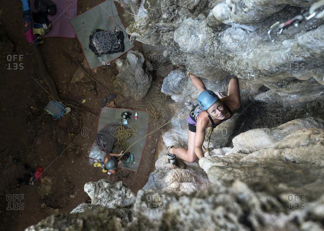 Thailand- Krabi- Railay Beach- woman climbing in rock wall