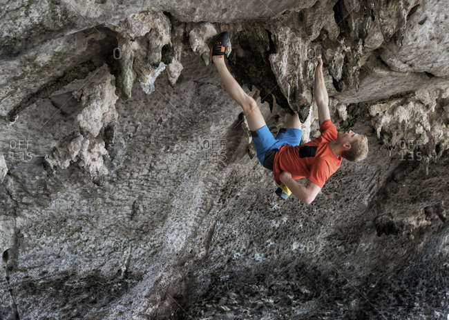 Thailand- Krabi- Lao liang island- man bouldering in rock wall
