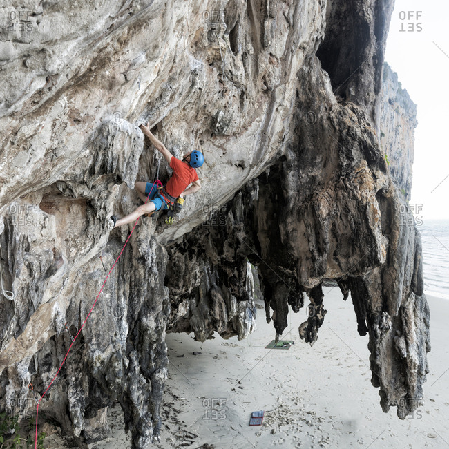 Thailand- Krabi- Lao liang island- climber in rock wall