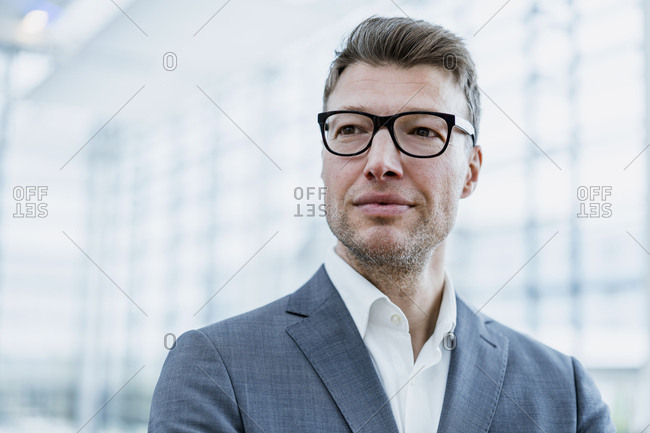 Portrait of confident businessman with glasses
