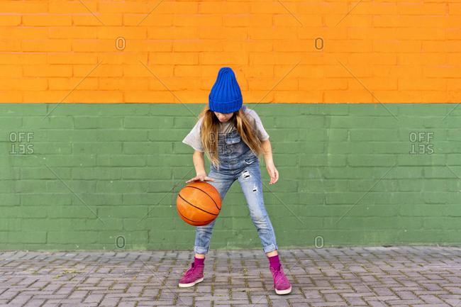 Young girl playing basketball- dribbling