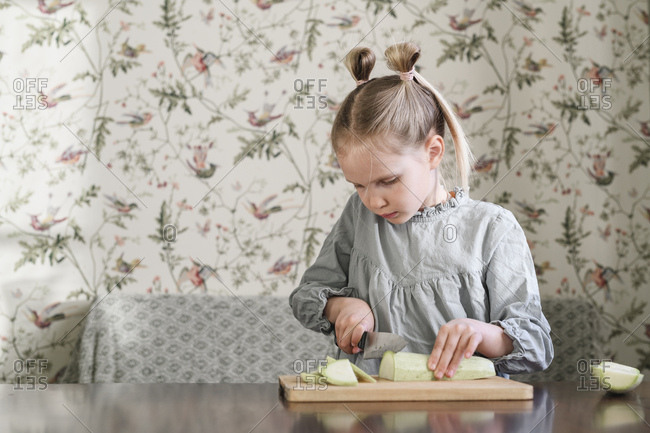 Girl slicing courgette