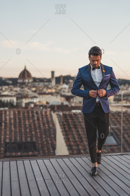 Italy- Florence- stylish man on roof terrace at sunset