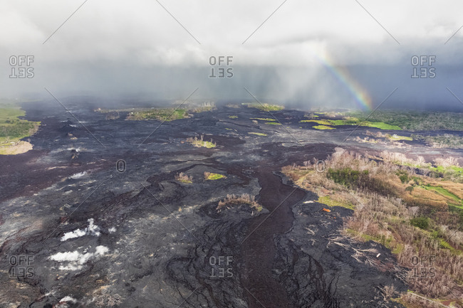 USA- Hawaii- Big Island- aerial view of the impacts of the volcanic eruption in 2018 with rainbow