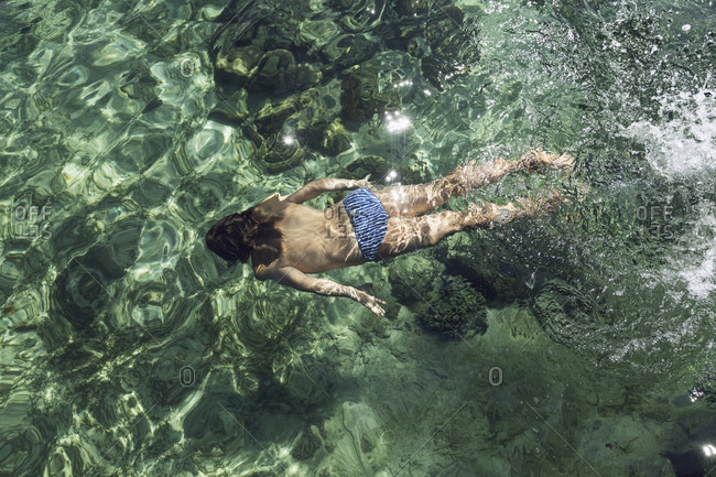 Indonesia- Komodo National Park- girl swimming in the sea