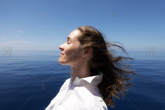 Seychelles- Indian Ocean- profile of woman on ferry enjoying breeze