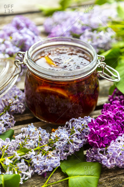 Preparation of lilac syrup- rosemary brown sugar and lemon