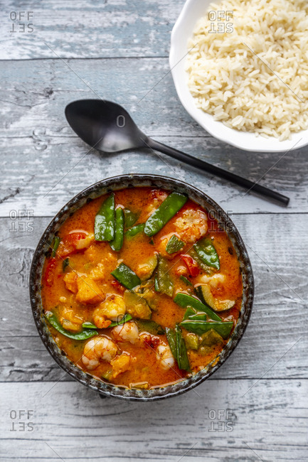 Red curry with sweet potato- yellow and red bell pepper- zucchini- sugar pea- shrimps and rice