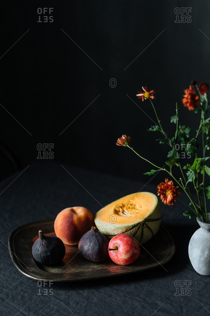 Fruit on tray on table with dark background