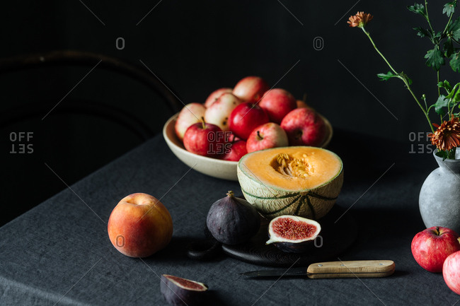 Variety of fruit and bowl of apples on table