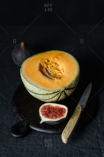 Sliced melon and figs on table
