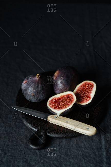 Sliced figs on dark background