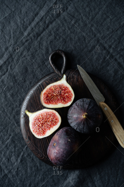 Overhead view of sliced figs on dark background