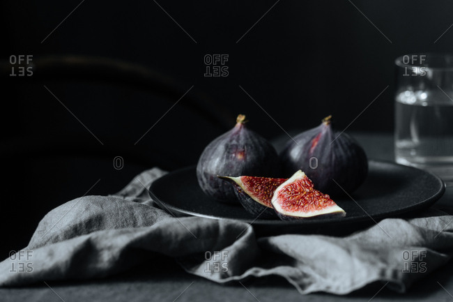 Figs on plate with dark background