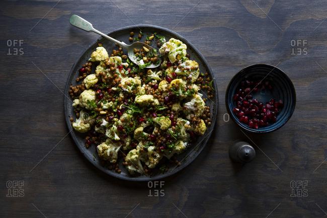 Cauliflower lentil zaatar salad and pomegranate dish
