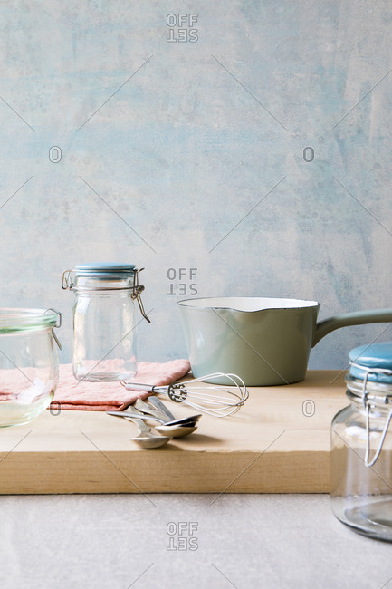 Glass storage jars and saucepan and whisk
