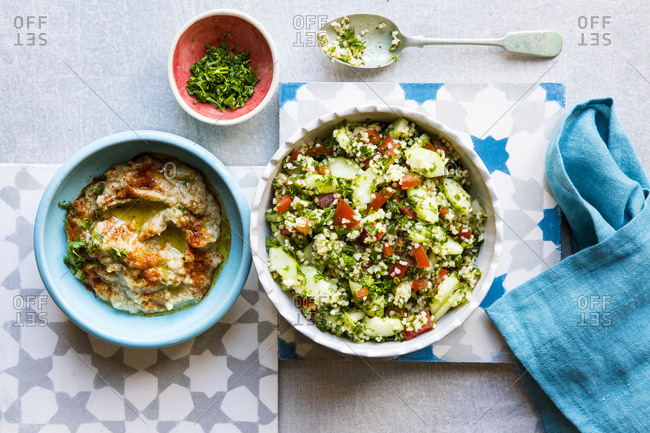 Lebanese food in bowls set on tiles