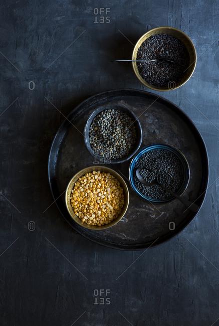 Lentil and black rice on dark surface