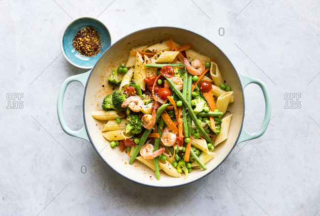 Pasta penne primavera and vegetables in skillet
