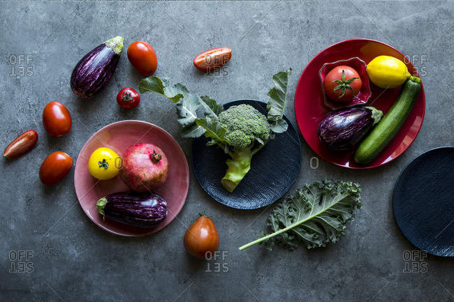 Vibrant red green purple and yellow vegetables.