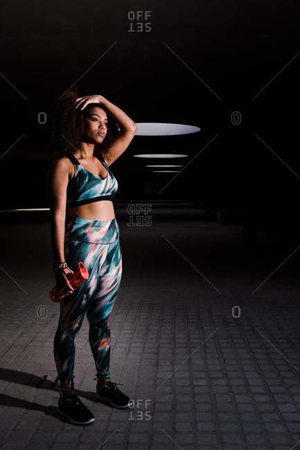 Curvy African American Woman Working Out In Urban Area