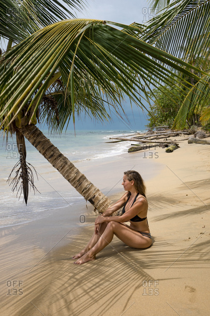 Woman relax on a  tropical beach in Costa Rica