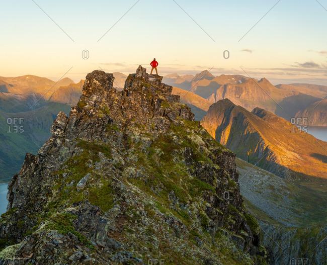 Man admiring view on top of mountain, Senja Island, Troms, Norway