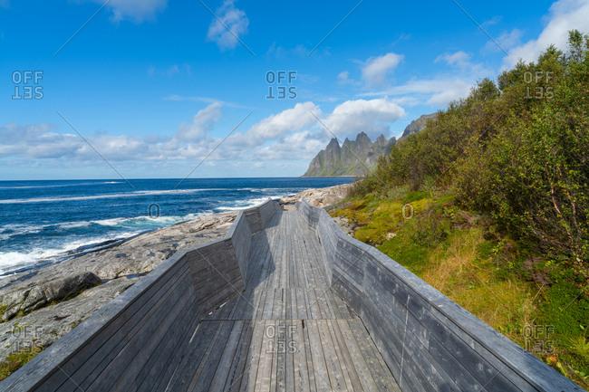 Walkway by The Devils Teeth, Okshornan Range, Tungeneset coastline, Senja Island, Troms, Norway