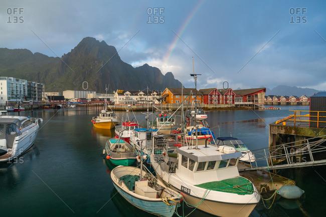 September 4, 2016: Boats in harbor & rainbow at Svolvaer, Lofoten Islands, Nordland, Norway