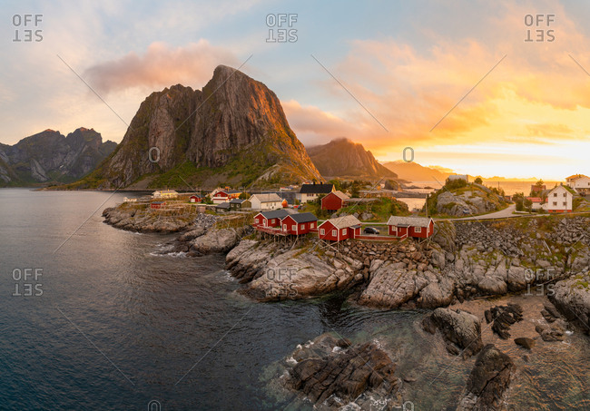 Red wooden huts, known as Rorbu, in the village of Reine on the Hamnoy island, Lofoten Islands, Norway. Rorbu is a Norwegian traditional house used by fishermen, today most are used by tourists.