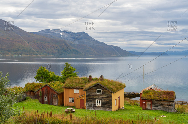 Traditional turf roofed wooden  houses, Senja Island, Troms county, Norway