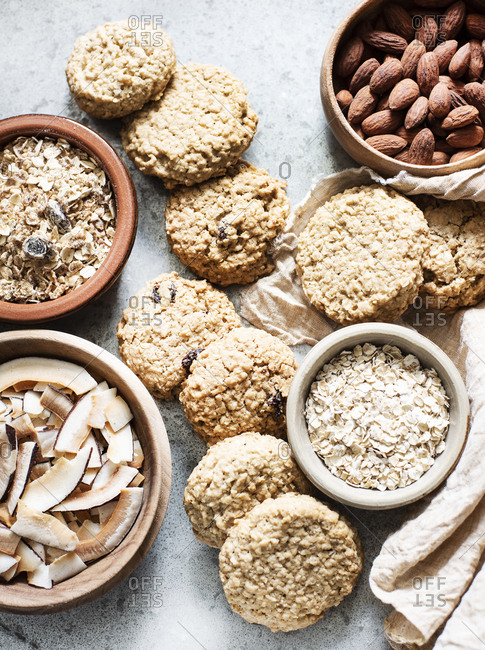 Ingredients for baking in bowls with cookies