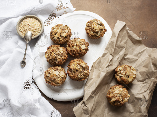 Overhead view of almond muffins with maple flakes