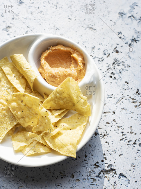 Tortilla chips with hummus spicy roasted dip