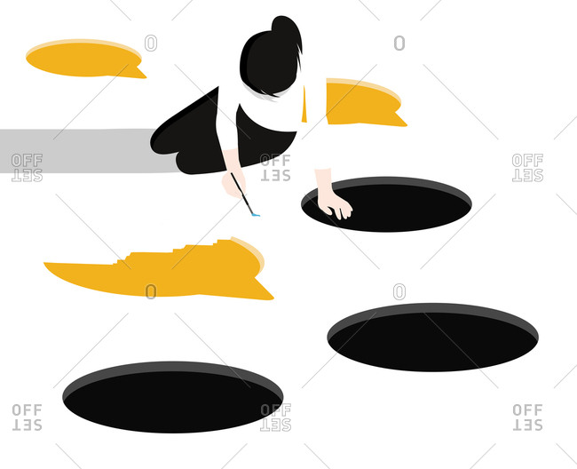 Woman drawing balloon and black holes