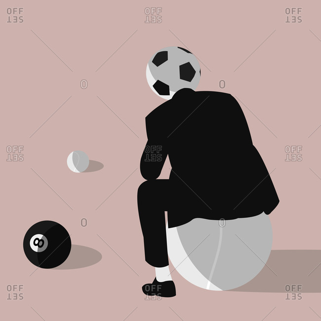Man from behind who thinks with soccer ball head