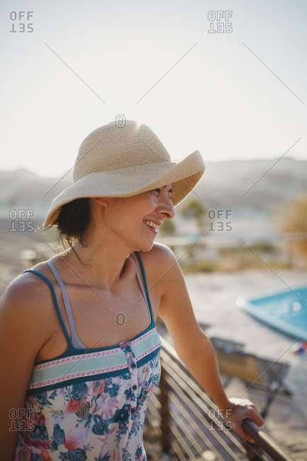 Woman wearing hat smiling in the desert