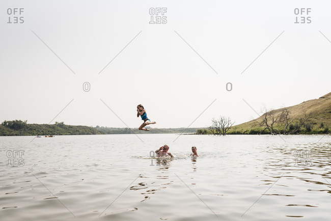 Girl thrown in air by Dad while swimming in lake in North Dakota